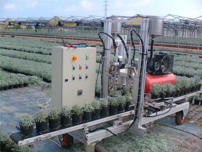 Potatrice per piante in vaso con concimatore